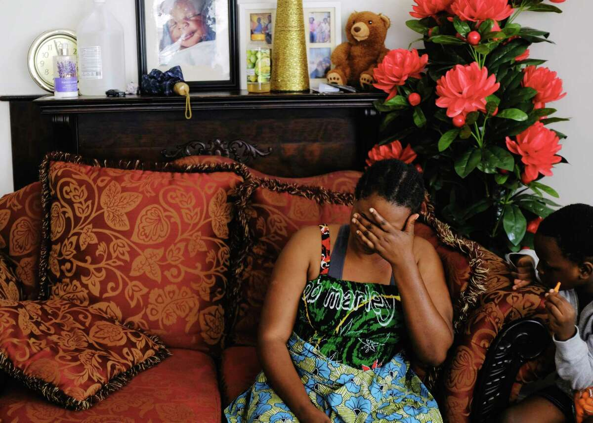 Sifa Eca becomes emotional as she talks about her financial struggles at her home on Monday, Oct. 5, 2020, in Albany, N.Y. (Paul Buckowski/Times Union)