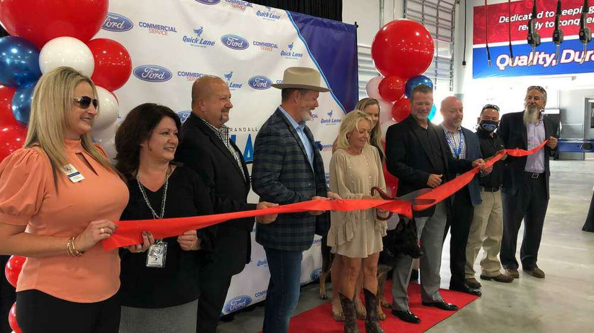 Randall Reed, Shelby Reed and Sherry Reed celebrated the ribbon cutting and grand opening on Oct. 1 of Randall Reed's Planet Commercial Service center, at 19214 US 59, in Humble.