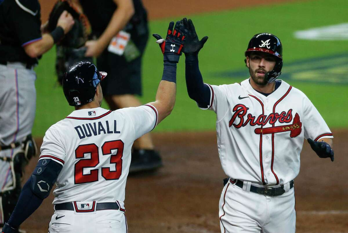 Atlanta Braves shortstop Dansby Swanson (7) celebrates after hitting a solo home run against the Miami Marlins during the second inning in Game 2 of the National League Division Series at Minute Maid Park on Wednesday, Oct. 7, 2020, in Houston.