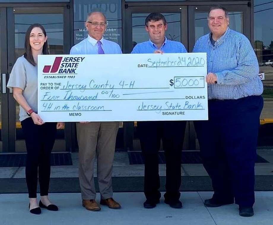 Jersey State Bank presents a $5,000 grant to Jersey County 4-H to provide positive youth development to local students through 4-H in the Classroom program. Pictured from left are Jessica Jaffry, 4-H Program Coordinator; Mark Schaefer, Jersey State Bank President/CEO; Chad Bowder, Vice President; and Tom Schnelt, Vice President.