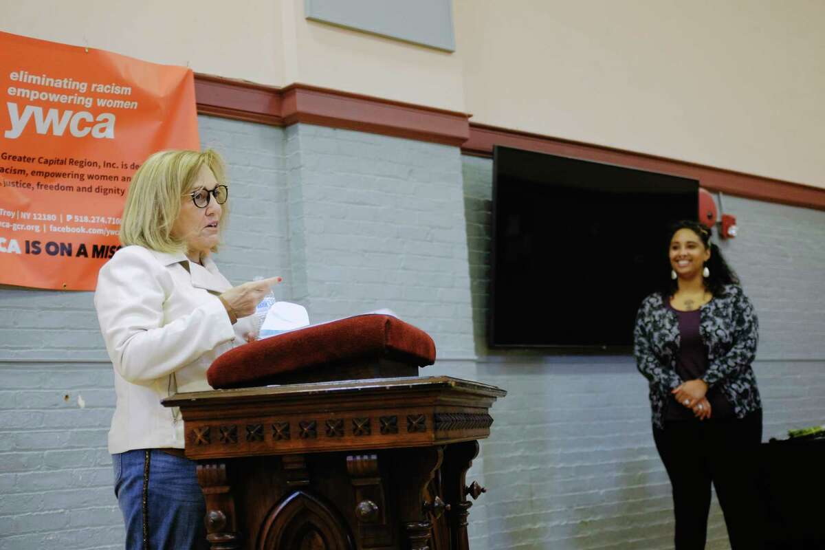 Sherry Rounds, left, a former executive director of the YWCA of the Greater Capital Region, and Starletta Smith, the executive director of YWCA-GCR, take part in a ceremony on Wednesday, Oct. 7, 2020, in Troy, N.Y. Rounds and Judge Beth Walsh were inducted as godmothers of the organization on Wednesday. The organization's Godparents are those who have given their time, talents, and treasures to the organization. The YWCA-GCR was founded in 1883. (Paul Buckowski/Times Union)