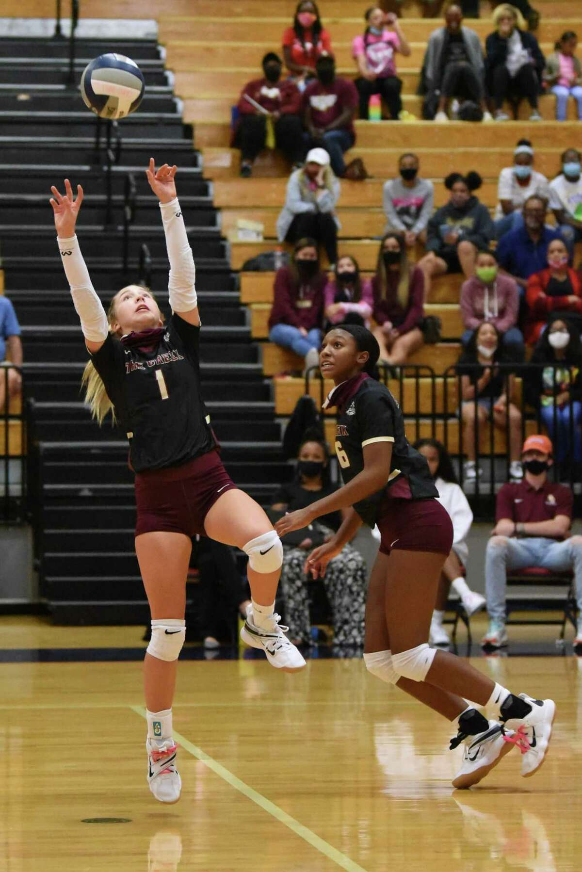 Summer Creek setter Jozie Dhayer setting up for an outside hitter against Humble ISD foe state ranked Atascocita.
