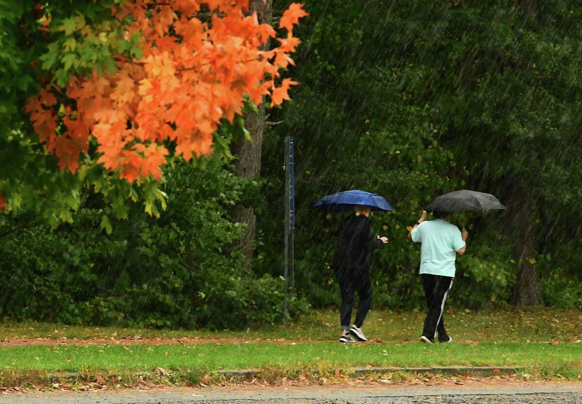 A couple of pedestrians take a walk in the rain in Saratoga Spa State Park on Wednesday, Oct. 7, 2020 in Saratoga Springs, N.Y. (Lori Van Buren/Times Union)