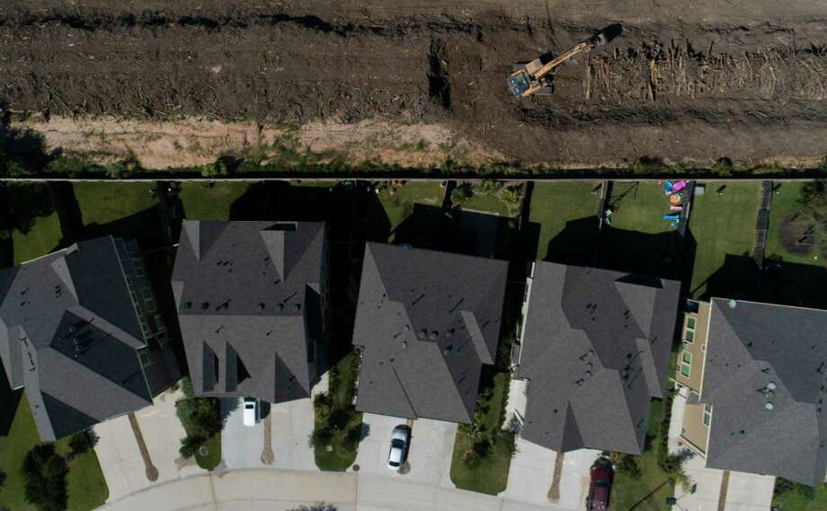Construction equipment clears the massive dumpsite of long pile of trees and debris on land owned by Hasara Land Services in the Woodforest subdivision, Wednesday, Oct. 7, 2020, in Montgomery. Photo: Jason Fochtman, Houston Chronicle / Staff Photographer / 2020 © Houston Chronicle