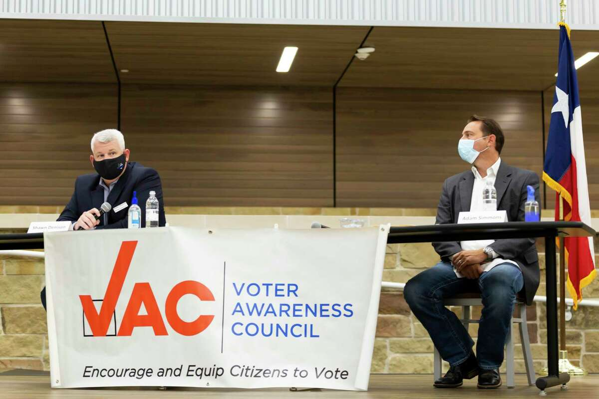 Shawn Denison, left, who's running against incumbent Adam Simmons for Position 2 speaks during a public forum held at Lake Creek High School for the Montgomery ISD Board of Trustees race, Tuesday, Oct. 6, 2020.