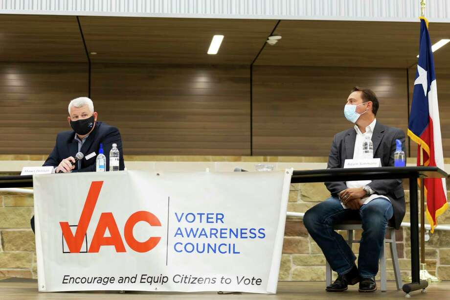 Shawn Denison, left, who's running against incumbent Adam Simmons for Position 2 speaks during a public forum held at Lake Creek High School for the Montgomery ISD Board of Trustees race, Tuesday, Oct. 6, 2020. Photo: Gustavo Huerta, Houston Chronicle / Staff Photographer / 2020 © Houston Chronicle