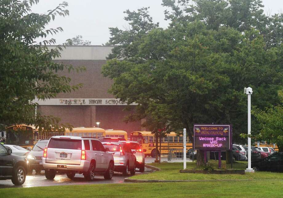 A sign reminds students to wear their masks as they return for the first day of the 2020-2021 school year at Westhill High School in Stamford, Conn. Thursday, Sept. 10, 2020. Photo: Tyler Sizemore / Hearst Connecticut Media / Greenwich Time