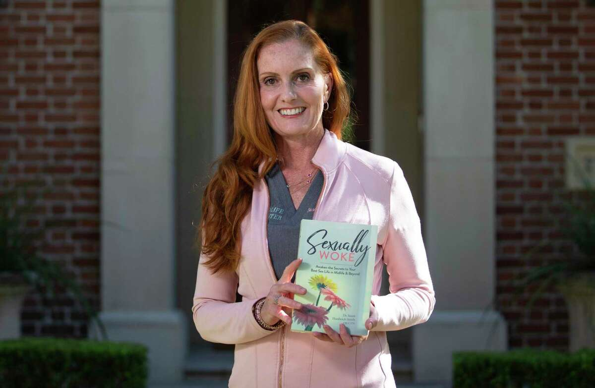 """Dr. Susan Hardwick-Smith, founder of Complete Women's Care Center, poses for a photograph with her new book, """" Sexually Woke,"""" Tuesday, Sept. 29, 2020, at West University in Houston. Hardwick-Smith just opened a new practice in September that specializes in midlife health and sexuality."""