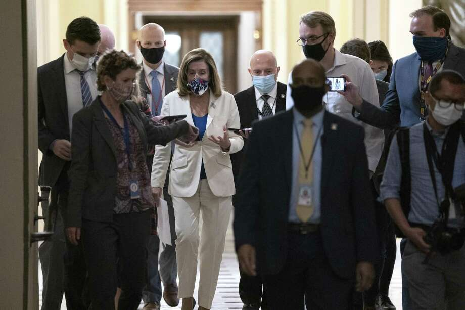 U.S. House Speaker Nancy Pelosi, a Democrat from California, center, speaks to members of the media as she walks to her office at the U.S. Capitol in Washington, D.C., U.S. on Thursday, Oct. 1, 2020. Talks Thursday between Pelosi and Treasury Secretary Steven Mnuchin brought no immediate breakthrough on a deal for a new pandemic relief package, while the House prepared to vote on a Democrat-only plan. Photographer: Stefani Reynolds/Bloomberg Photo: Stefani Reynolds / Bloomberg / © 2020 Bloomberg Finance LP