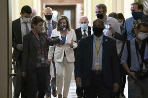 U.S. House Speaker Nancy Pelosi, a Democrat from California, center, speaks to members of the media as she walks to her office at the U.S. Capitol in Washington, D.C., U.S. on Thursday, Oct. 1, 2020. Talks Thursday between Pelosi and Treasury Secretary Steven Mnuchin brought no immediate breakthrough on a deal for a new pandemic relief package, while the House prepared to vote on a Democrat-only plan. Photographer: Stefani Reynolds/Bloomberg