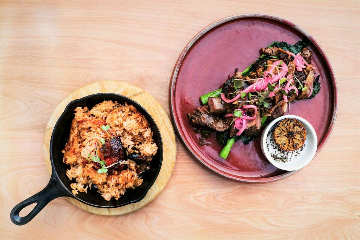 The Shake 'n Steak dish comes with Texas Waygu shaken beef with shiitake mushrooms, pickled onion, grilled Chinese broccoli, roasted tomato rice and an accompanying side of lemon pepper salt.