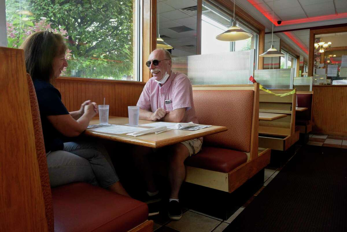 Patrick O'Brien, of Brookfield, has a birthday lunch with his wife Deborah at Elmer's Diner on Monday. Elmer's and other restaurants, will be permitted to open to 75 percent capacity inside beginning October 8 per Connecticut's phase three reopening rules. Monday, September 28, 2020, in Danbury, Conn.