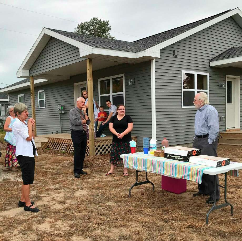 Family members,Habitat for Humanity Benzie Countyvolunteersand friends gathered to participate in a House Blessing for Kayla Russell held on Sept. 27. (Courtesy Photo/Molly Biddle)