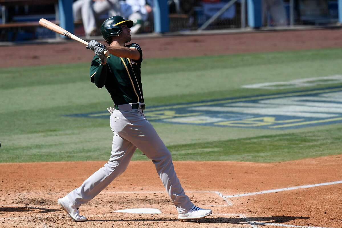 Matt Olson #28 of the Oakland Athletics hits a solo home run against the Houston Astros during the fourth inning in Game Three of the American League Division Series at Dodger Stadium on October 07, 2020 in Los Angeles, California.