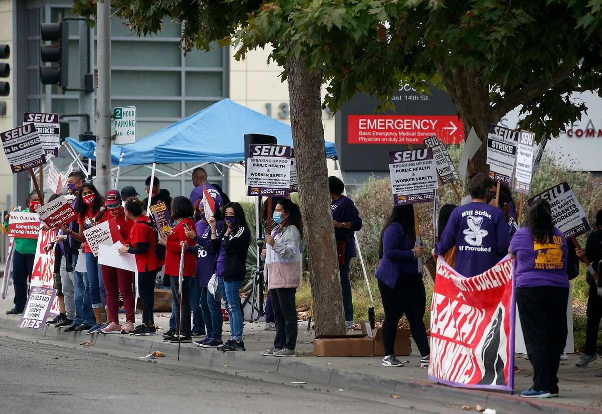 Nurses walk the picket line at San Leandro Hospital during a weeklong strike of East Bay hospitals.