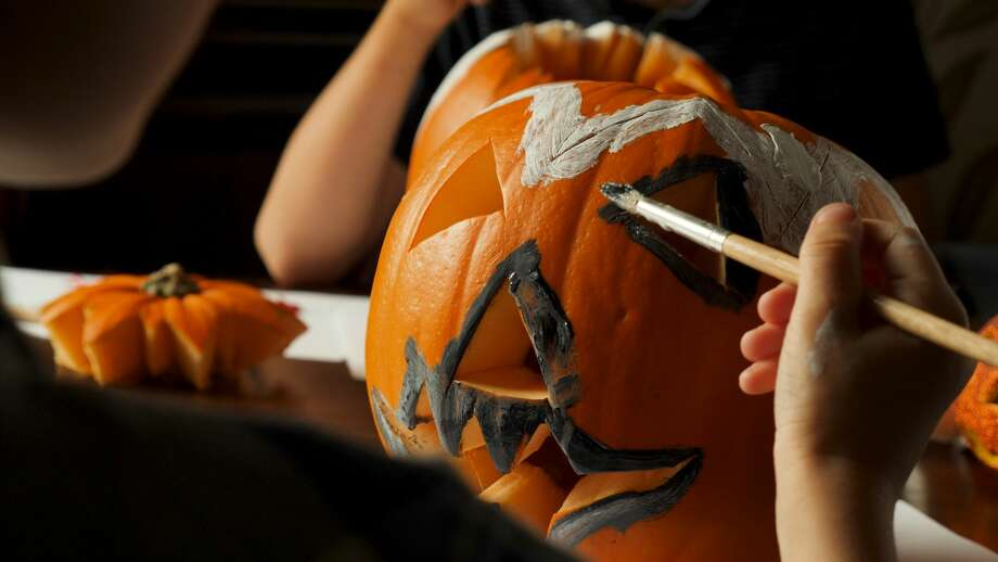 Pumpkin painting success starts with picking the pumpkin. Choose one with a smooth, flat, ridge-free surface. Photo: Antons Jevterevs