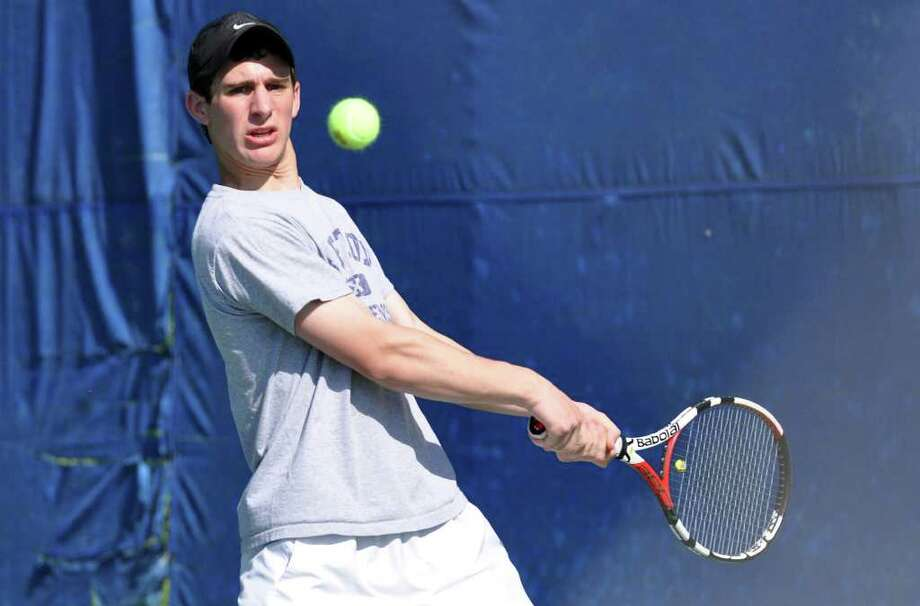 Weston's Jeremy Schwartz, playing first singles, keeps his eye on the ball during Friday's boys tennis match against Pomperaug. Photo: Amy Mortensen / Connecticut Post