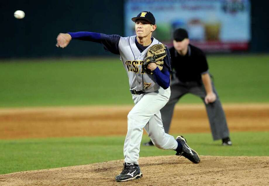 Weston's Cody Nusbaum pitches during Friday night's game against Newtown at the Arena at Harbor Yard in Bridgeport. Photo: Autumn Driscoll, ST / Connecticut Post