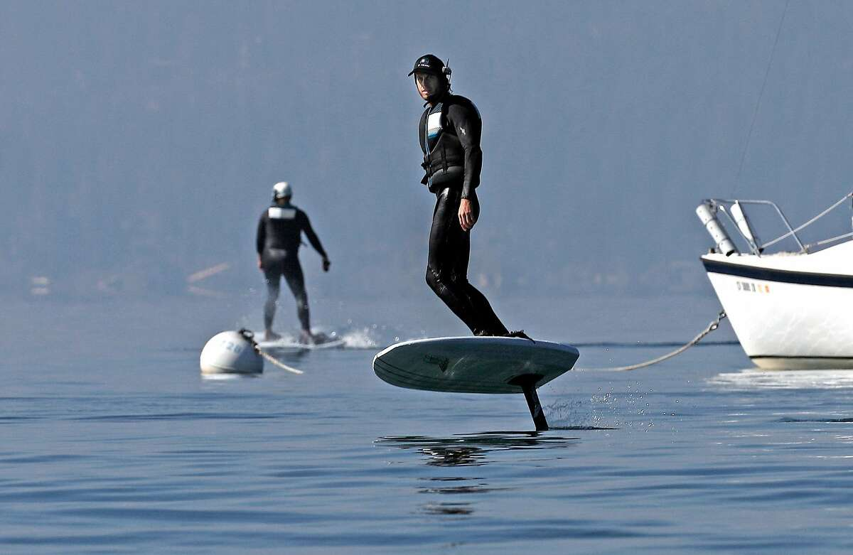 Instructor Matt Cook (right), along with student Connor Bugbee, during an efoil class at Kings Beach.