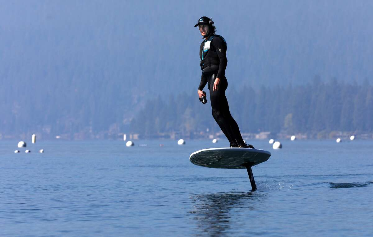 Instructor Matt Cook carves a turn on Lake Tahoe during an efoil lesson at Kings Beach, Ca., Thurs. on Oct. 1, 2020.