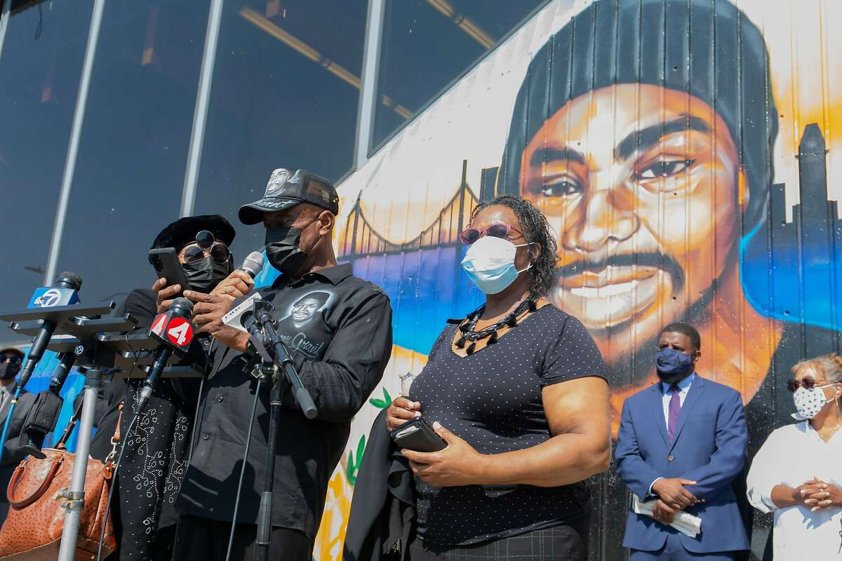 Oscar Grants family members read out a text message from the office of Alameda County District Attorney, Nancy O'Malley, announcing that they plan to re-open Oscar Grant's murder case on October 5, 2020 at a press conference held where he was murdered 11 years ago by a Bart Police officer at the Fruitvale Bart station.