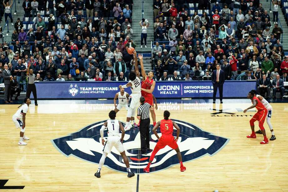 The UConn and Arizona men's basketball teams tip off at the XL Center in Hartford in 2018. UConn will not play any basketball or hockey games there this season due to the pandemic. Photo: Gregory Fisher / Icon Sportswire Via Getty Images / ©Icon Sportswire (A Division of XML Team Solutions) All Rights Reserved ©Icon Sportswire (A Division of XML Team Solutions)