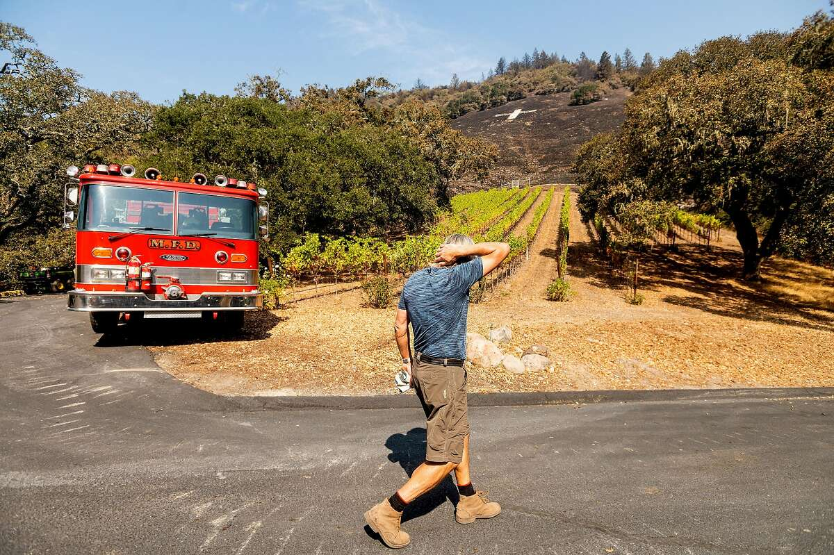 Bjarne Hansen, who defended his home during the first night of the Glass Fire and bought a fire truck three days later, walks past his vineyard in Santa Rosa on Tuesday.