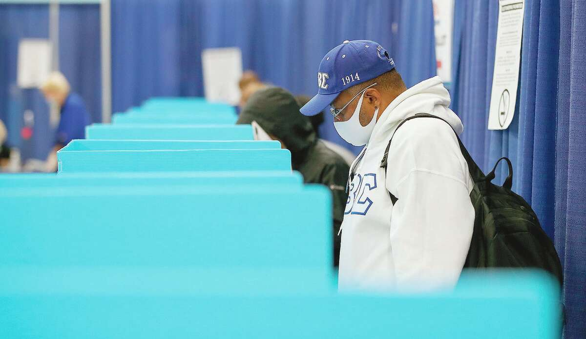 A voters casts his ballot for the Nov. 3 election at an early voting location.