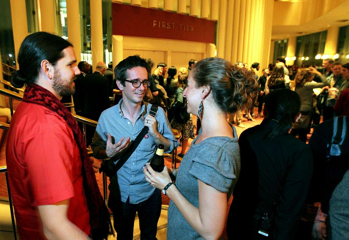 Pop-Up Magazine Editor-in-Chief Douglas McGray center, chats with Theo Rigby and Katina Papson-Rigby at a reception following a 2012 performance in San Francisco. While California Sunday magazine has closed, pop-up events will continue virtually, and then in person as health orders permit.
