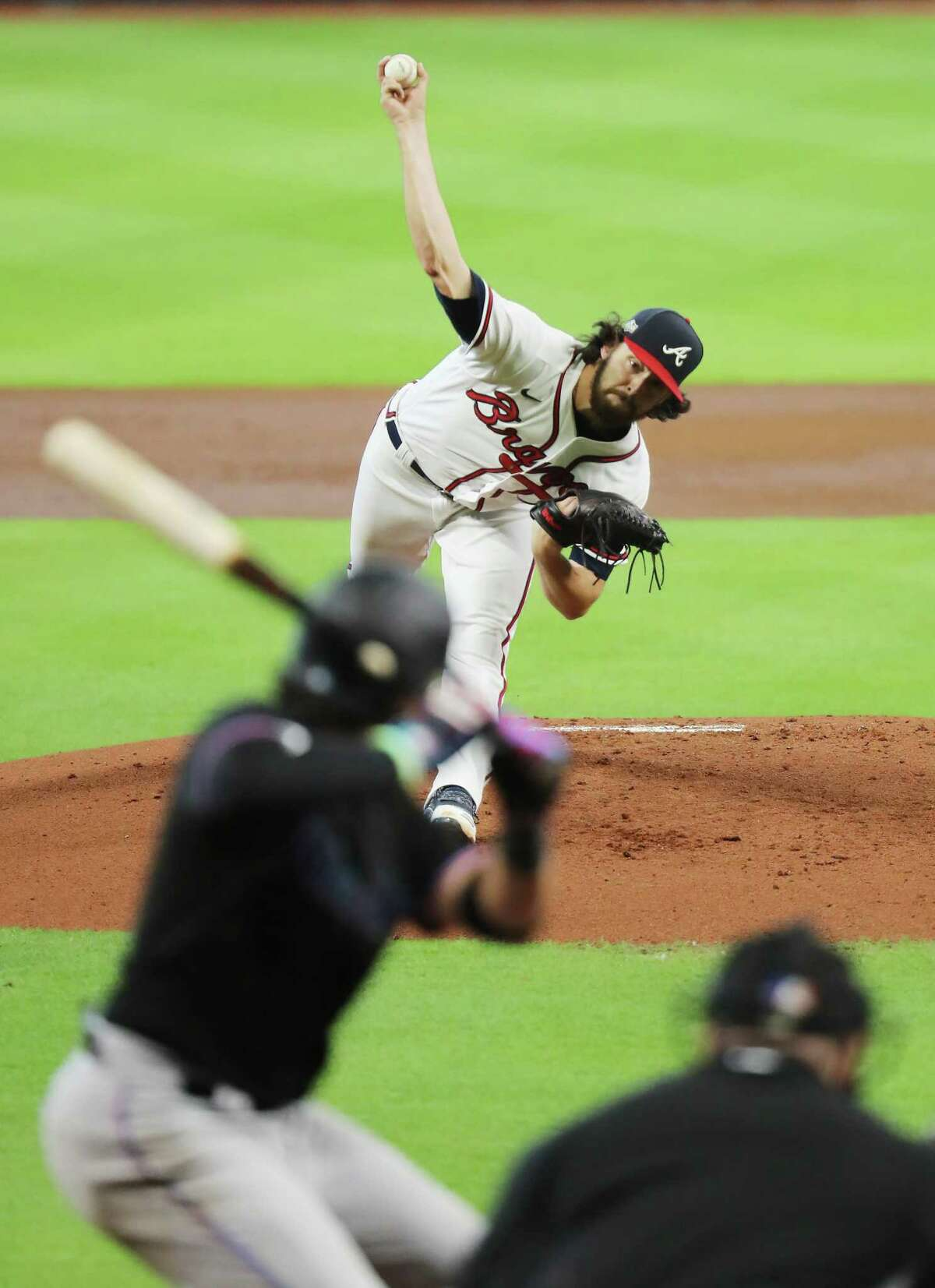 HOUSTON, TEXAS - OCTOBER 07: Ian Anderson #48 of the Atlanta Braves delivers a pitch against the Miami Marlins in Game Two of the National League Division Series at Minute Maid Park on October 07, 2020 in Houston, Texas.