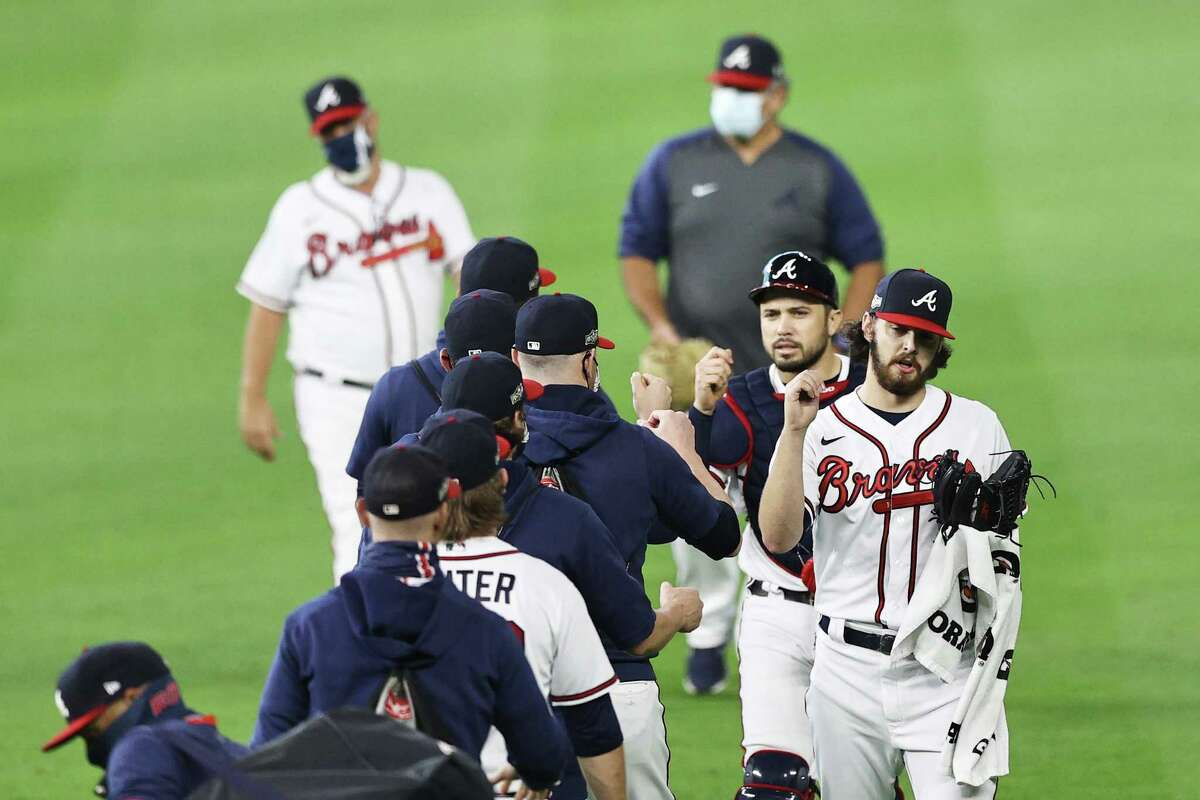 HOUSTON, TEXAS - OCTOBER 07: Ian Anderson #48 of the Atlanta Braves greets teammates prior to Game Two of the National League Division Series against the Miami Marlins at Minute Maid Park on October 07, 2020 in Houston, Texas.