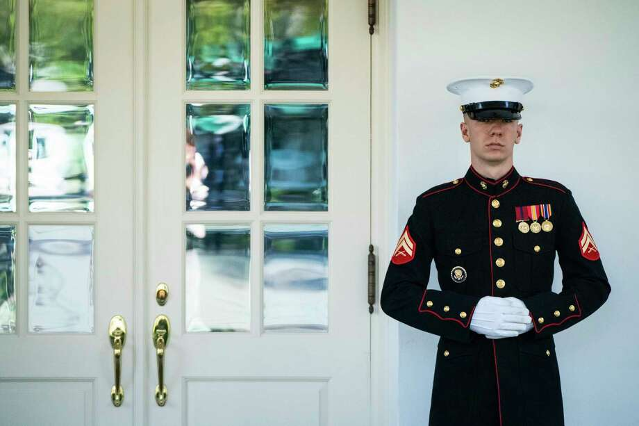 A Marine stands guard outside the West Wing doors on Wednesday at the White House. Photo: Washington Post Photo By Jabin Botsford / The Washington Post