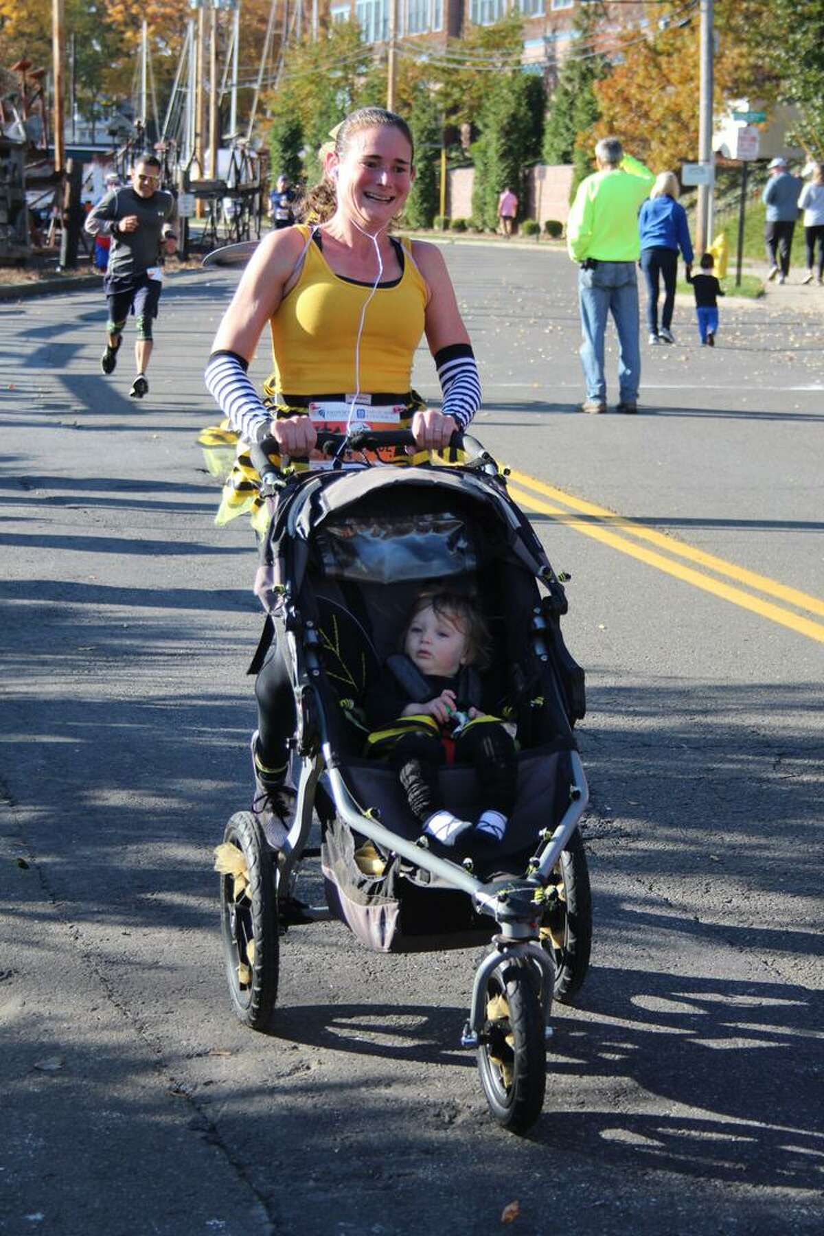 Families and individuals dressed up in costume while they ran in the 2019 Milford Trick or Trot 5K fundraiser for the Beth-El Center homeless shelter and soup kitchen.