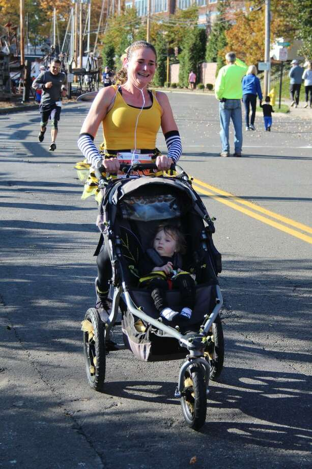 Families and individuals dressed up in costume while they ran in the 2019 Milford Trick or Trot 5K fundraiser for the Beth-El Center homeless shelter and soup kitchen. Photo: Contributed / The Beth-El Center