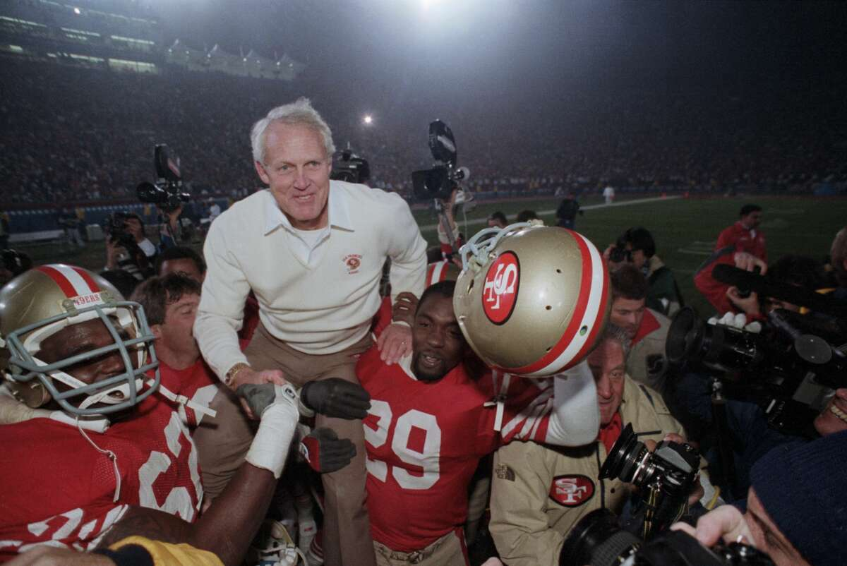 San Francisco 49ers players carry their coach Bill Walsh off the field after they win the 1985 Super Bowl.