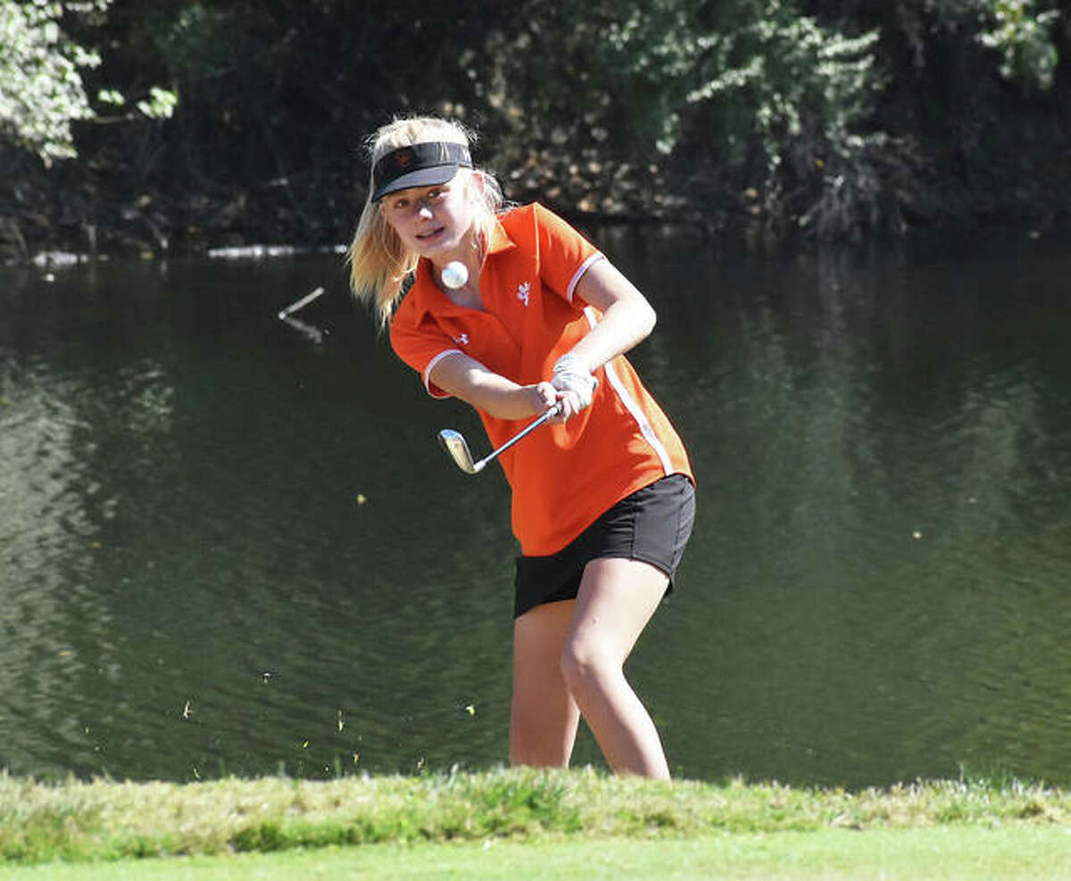 Edwardsville freshman Caitlyn Dicks chips her shot onto the green on the fifth hole on Wednesday during the Class 2A Marion Regional.