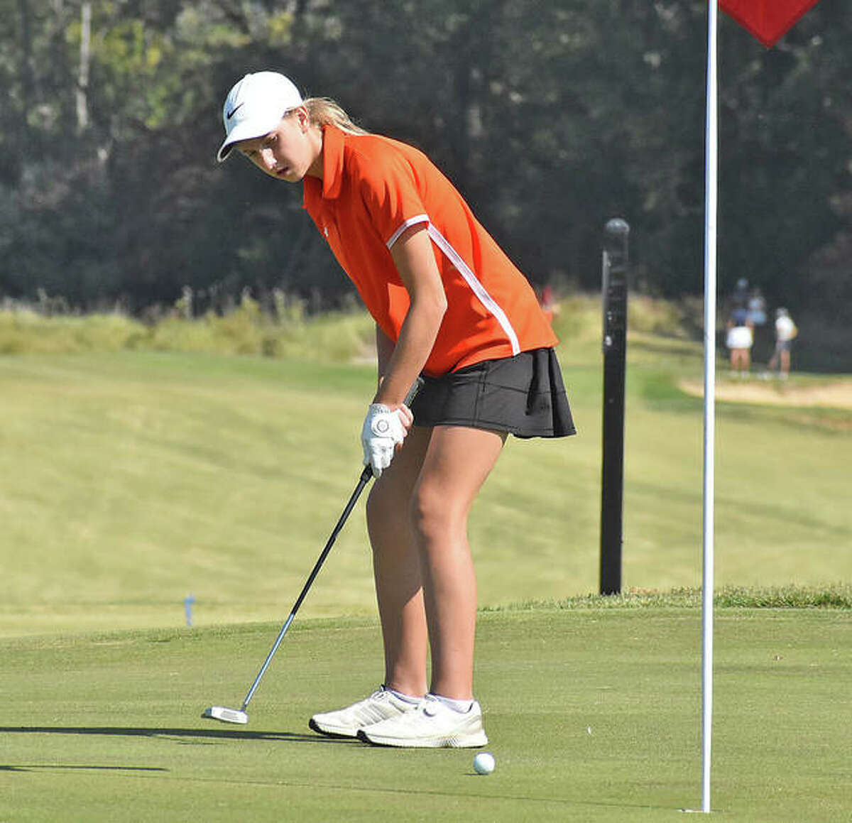 Edwardsville junior Grace Daech rolls her birdie attempt towards the first hole on Wednesday during the Class 2A Marion Regional.