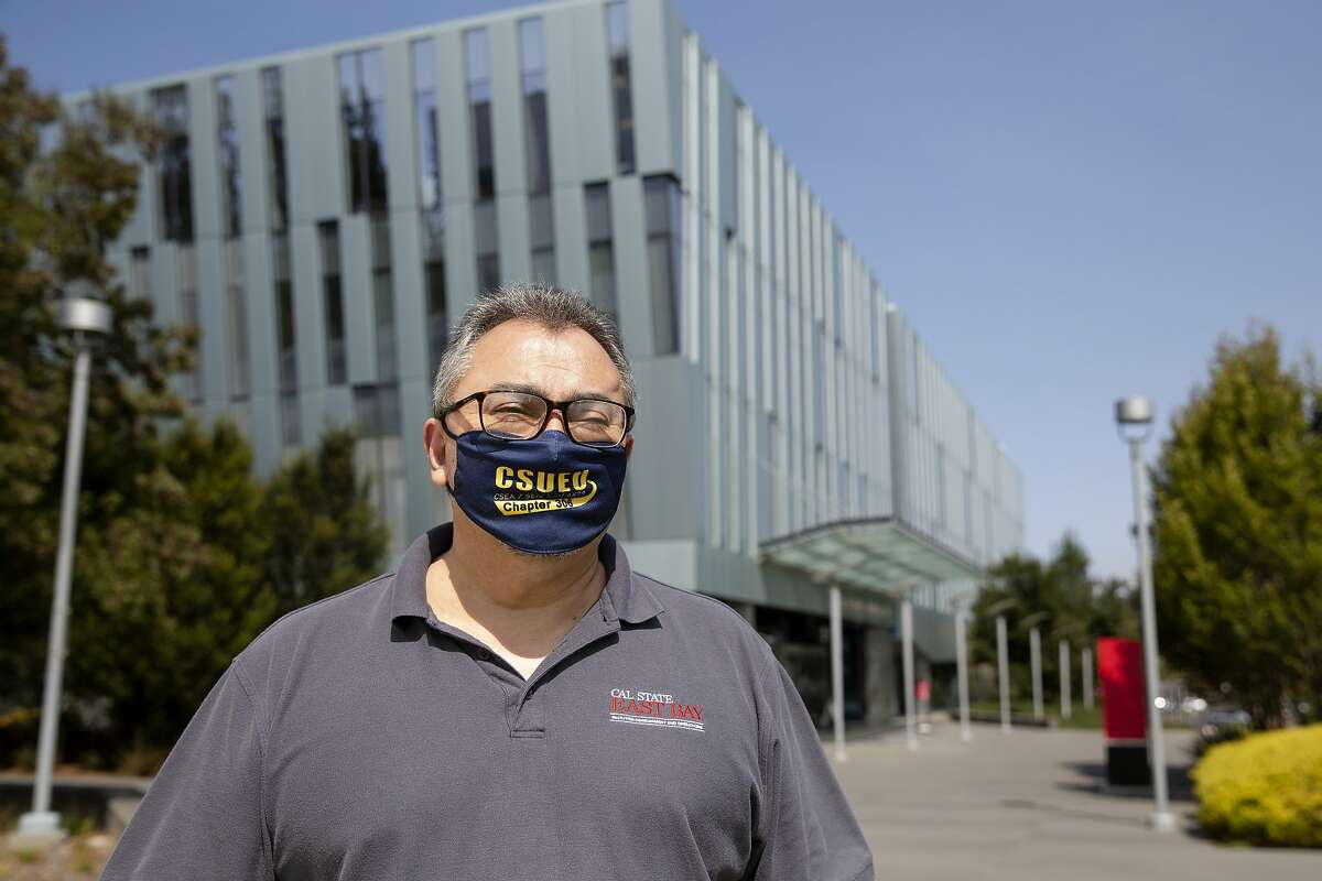 Diego Campos, president of the campus Employees union and a staff buyer, stands for a portrait at California State University East Bay's campus in Hayward, Calif. on Thursday, September 17, 2020.