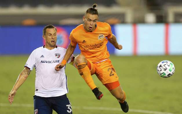 Houston Dynamo defender Sam Junqua (29) gets a pass while FC Dallas defender Reto Ziegler (3) looks on during the first half of a MLS match Wednesday, Oct. 7, 2020, at BBVA Stadium in Houston. Photo: Yi-Chin Lee, Staff Photographer / © 2020 Houston Chronicle