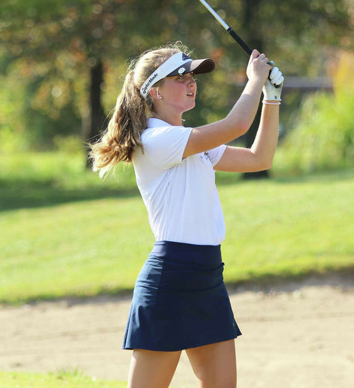 Father McGivney's Ellie Hyten watches her shot on hole No. 9 at Spencer T. Olin Golf Course on Wednesday during the Class 1A Alton Marquette Regional.