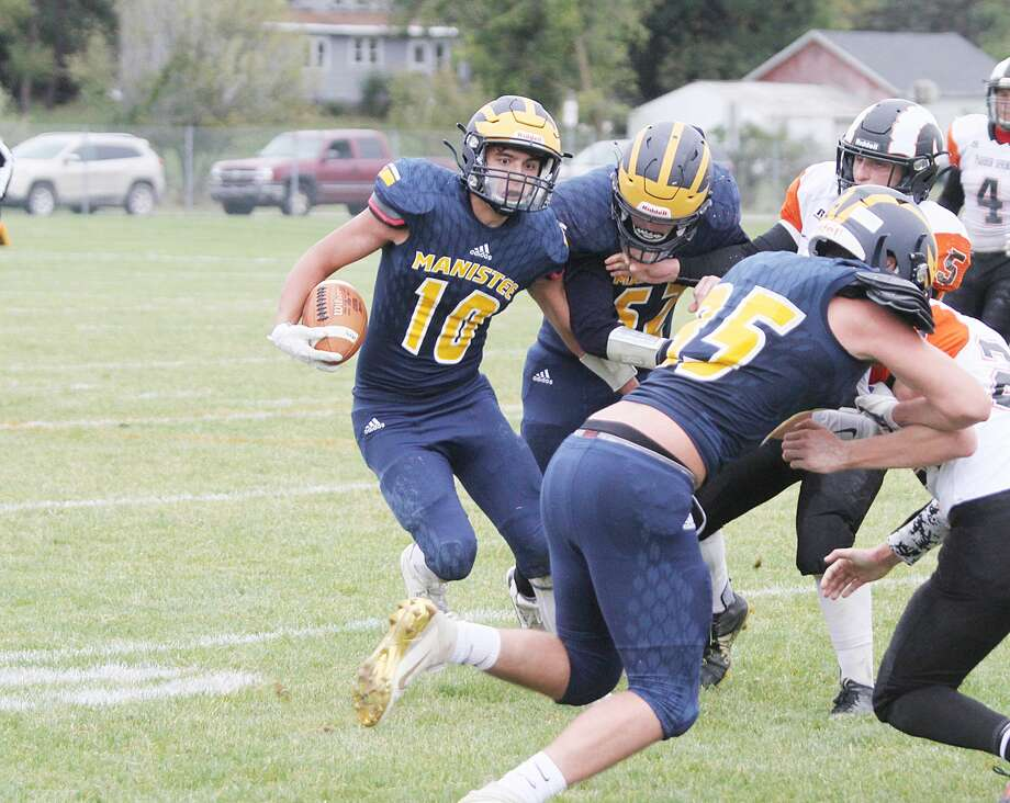 Manistee's Trevor Mikula looks for room to run during the Chippewas' victory over Harbor Springs on Saturday. Manistee will kick off with Muskegon Catholic Central at 7 p.m. on Friday at Chippewa Field. Photo: Dylan Savela/News Advocate