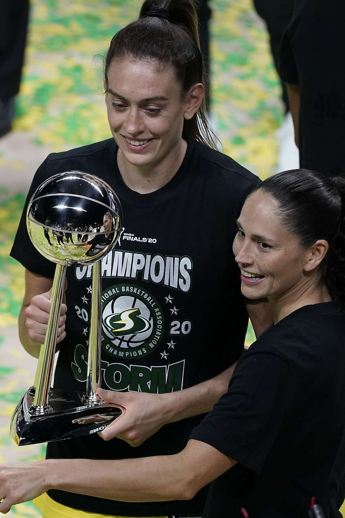 Seattle Storm forward Breanna Stewart, left, and Sue Bird celebrate after the team won basketball's WNBA Championship Tuesday, Oct. 6, 2020, in Bradenton, Fla. The STorm defeated the Las Vegas Aces to win the title. (AP Photo/Chris O'Meara)