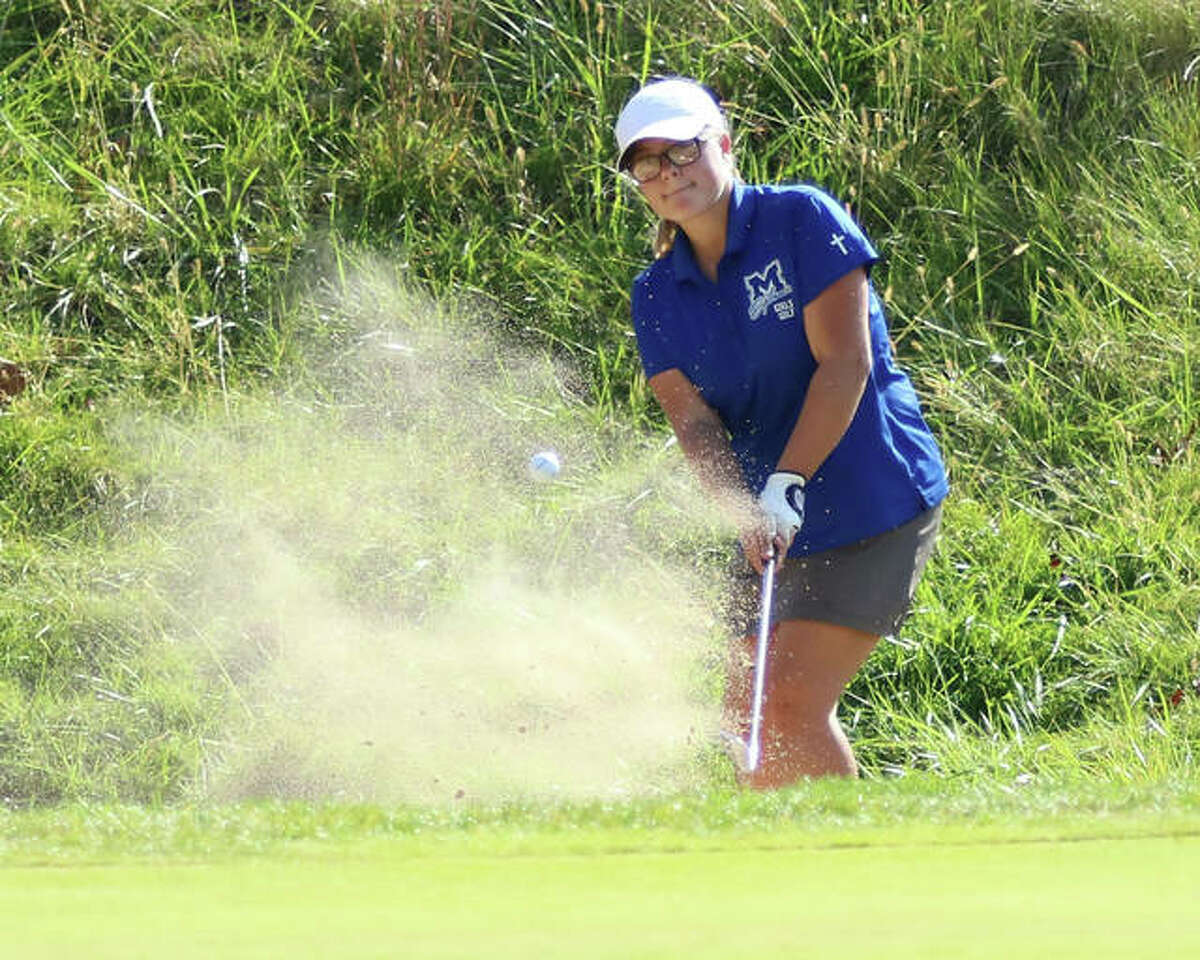 Marquette Catholic's Audrey Cain hits from a bunker on the 11th hole at Spencer T. Olin on Wednesday afternoon in the Marquette Class 1A Regional girls golf tourney in Alton. Cain shot 80 to finish second in the regional.