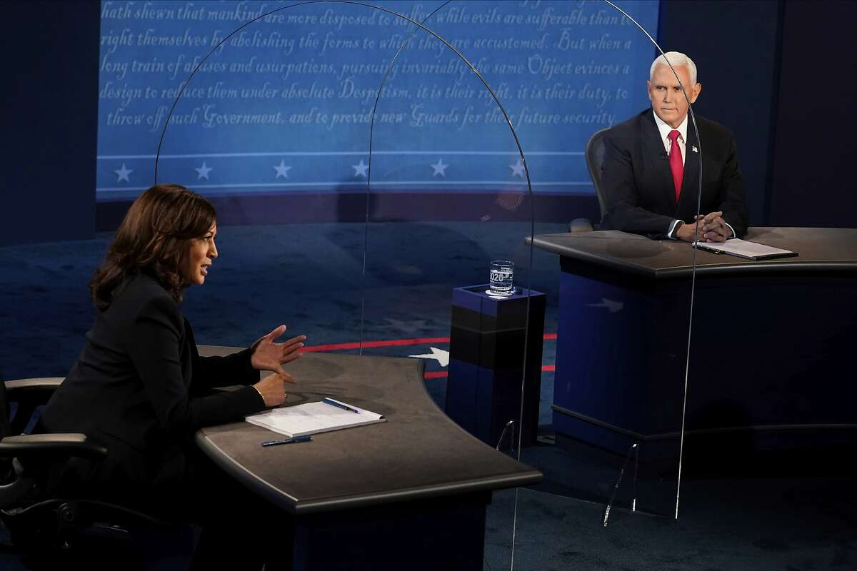 """Sen. Kamala Harris (left) during the debate often cut off Vice President Mike Pence's attempts to interrupt her with a polite but firm """"I'm speaking."""""""