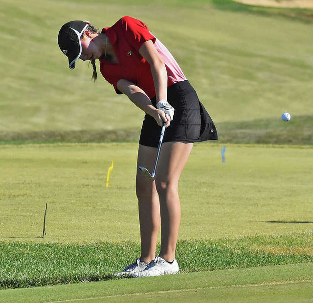 Alton's Natalie Messinger hits a shot on the first hole at Kokopelli Golf Club on Wednesday at the Marion Class 2A Regional. Messinger shot 80 to advance to the sectional.