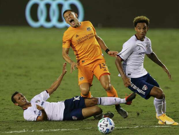 Houston Dynamo forward Christian Ramirez (13) is brought down by FC Dallas midfielder Ricaurte Velez (10) while trying to take a shot at the goal during the second half of a MLS match Wednesday, Oct. 7, 2020, at BBVA Stadium in Houston. Houston Dynamo defeated FC Dallas 2-0. Photo: Yi-Chin Lee, Staff Photographer / © 2020 Houston Chronicle