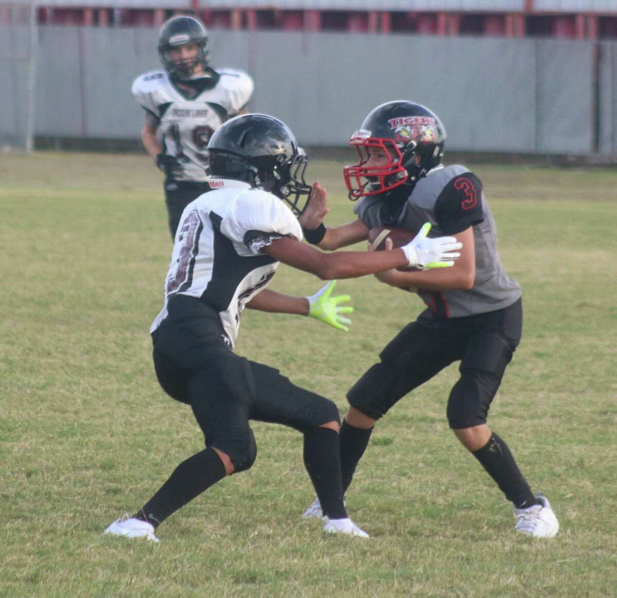 San Jacinto Intermediate 8B quarterback Jasiah Mata gets turned in the wrong direction by a Victory Lakes defender during Wednesday's game.