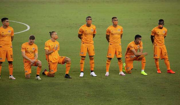 Some Houston Dynamo players choose to kneel during the national anthem at a MLS match against the FC Dallas Wednesday, Oct. 7, 2020, at BBVA Stadium in Houston. Photo: Yi-Chin Lee, Staff Photographer / © 2020 Houston Chronicle