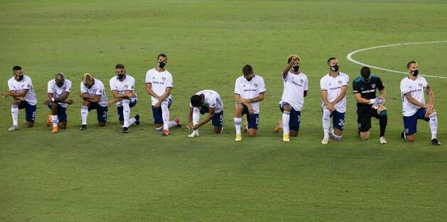 All FC Dallas players take a knee during the national anthem at a MLS match against the against the Houston Dynamo Wednesday, Oct. 7, 2020, at BBVA Stadium in Houston. Photo: Yi-Chin Lee, Staff Photographer / © 2020 Houston Chronicle