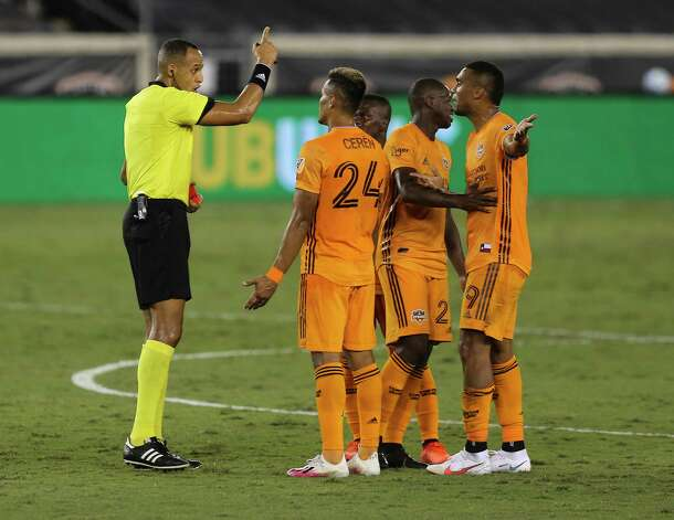 Houston Dynamo forward Mauro Manotas (9) argues with referee Ismail Elfath after Elfath issued him a red card during the first half of a MLS match against the FC Dallas Wednesday, Oct. 7, 2020, at BBVA Stadium in Houston. Photo: Yi-Chin Lee, Staff Photographer / © 2020 Houston Chronicle